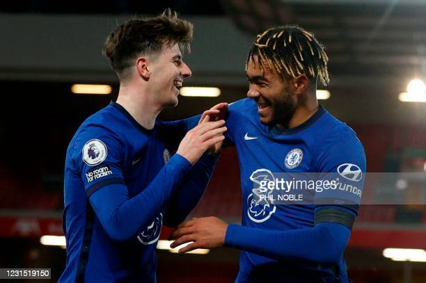 Chelsea's English midfielder Mason Mount celebrates scoring the opening goal during the English Premier League football match between Liverpool and...