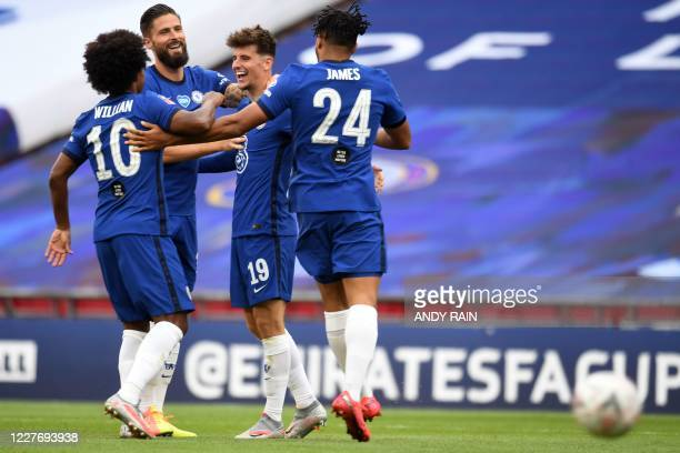 Chelsea's English midfielder Mason Mount celebrates with teammates after scoring their second goal during the English FA Cup semifinal football match...
