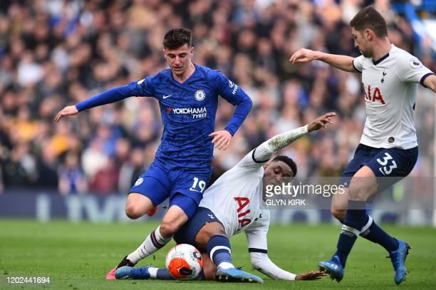 Chelsea's English midfielder Mason Mount is tackled by Tottenham Hotspur's Dutch midfielder Steven Bergwijn as Tottenham Hotspur's Welsh defender Ben...