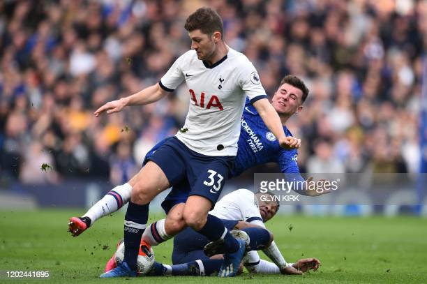 TOPSHOT Chelsea's English midfielder Mason Mount is tackled by Tottenham Hotspur's Dutch midfielder Steven Bergwijn as Tottenham Hotspur's Welsh...