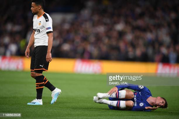 TOPSHOT Chelsea's English midfielder Mason Mount lies injured during the UEFA Champion's League Group H football match between Chelsea and Valencia...