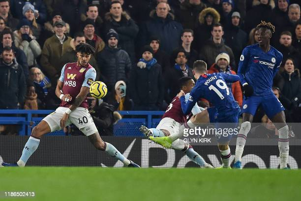 Chelsea's English midfielder Mason Mount scores his team's second goal during the English Premier League football match between Chelsea and Aston...