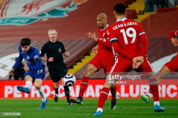 Chelsea's English midfielder Mason Mount shoots to score the opening goal during the English Premier League football match between Liverpool and...