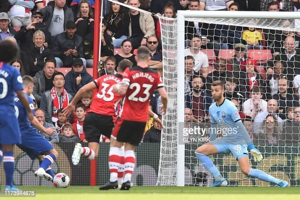 Chelsea's English midfielder Mason Mount shoots to score their second goal past Southampton's English goalkeeper Angus Gunn during the English...
