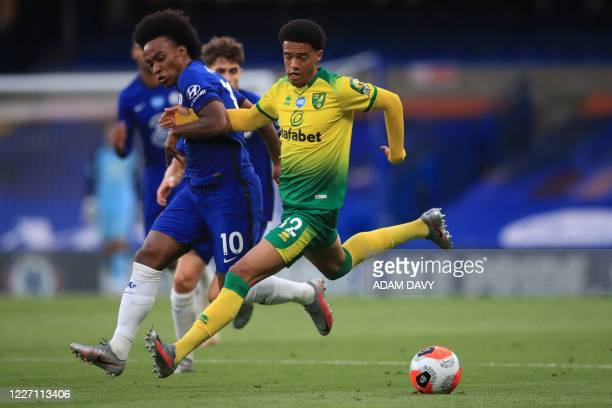 Chelsea's English midfielder Mason Mount vies with Norwich City's English-born Northern Irish defender Jamal Lewis during the English Premier League...