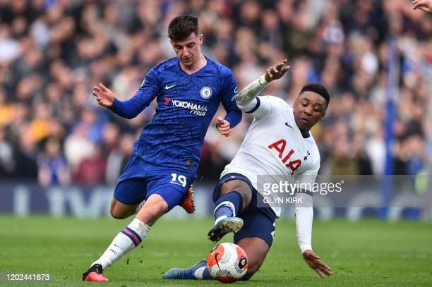 Chelsea's English midfielder Mason Mount vies with Tottenham Hotspur's Dutch midfielder Steven Bergwijn during the English Premier League football...