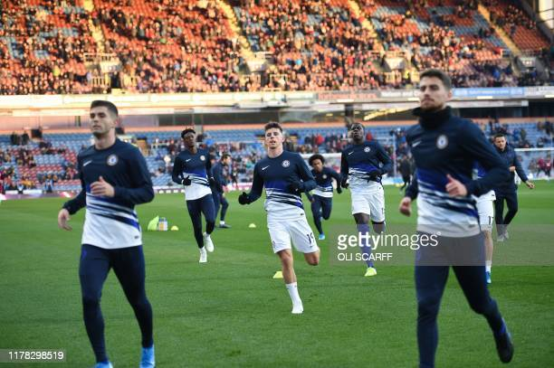 Chelsea's English midfielder Mason Mount warms up for the English Premier League football match between Burnley and Chelsea at Turf Moor in Burnley...
