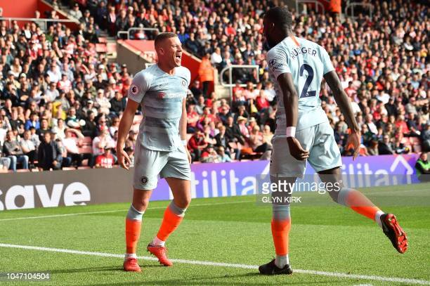 Chelsea's English midfielder Ross Barkley celebrates scoring his team's second goal during the English Premier League football match between...
