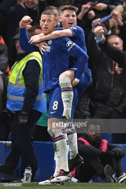 Chelsea's English midfielder Ross Barkley celebrates scoring his team's second goal with Chelsea's Scottish midfielder Billy Gilmour during the...