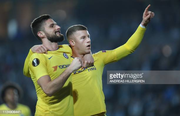 TOPSHOT Chelsea's English midfielder Ross Barkley celebrates scoring the 01 goal with Chelsea's French striker Olivier Giroud during the UEFA Europa...
