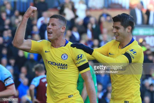 Chelsea's English midfielder Ross Barkley celebrates with Chelsea's Spanish striker Alvaro Morata after scoring their second goal during the English...