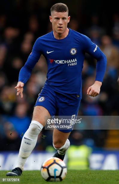 Chelsea's English midfielder Ross Barkley runs with the ball during the English FA Cup fourth round football match between Chelsea and Newcastle...