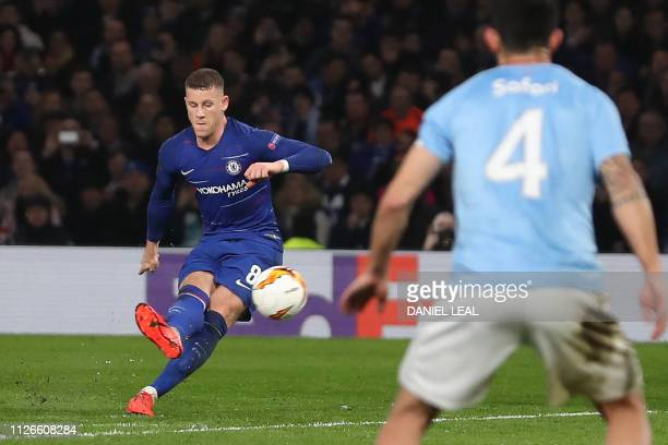 Chelsea's English midfielder Ross Barkley scores their second goal from this freekick during the UEFA Europa League round of 32 2nd leg football...