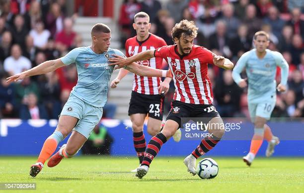 Chelsea's English midfielder Ross Barkley vies with Southampton's Italian striker Manolo Gabbiadini during the English Premier League football match...