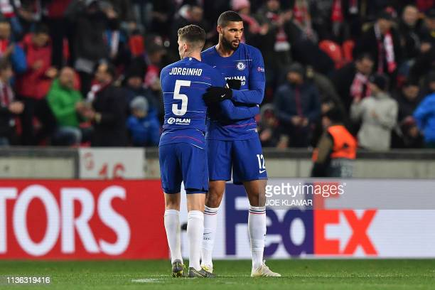 Chelsea's English midfielder Ruben LoftusCheek and Chelsea's Italian midfielder Jorginho celebrate after the UEFA Europa League quarterfinal first...