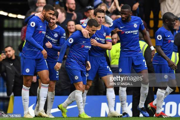 Chelsea's English midfielder Ruben LoftusCheek celebrates with teammates after scoring their second goal during the English Premier League football...