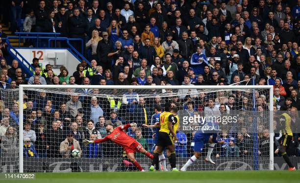 TOPSHOT Chelsea's English midfielder Ruben LoftusCheek scores the opening goal past Watford's English goalkeeper Ben Foster during the English...
