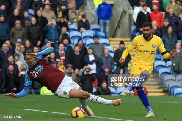 Chelsea's English midfielder Ruben LoftusCheek shoots past Burnley's English defender Matthew Lowton to score their fourth goal during the English...