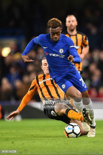 Chelsea's ENglish striker Callum HudsonOdoi is tackled by Hull City's Welsh midfielder Harry Wilson during the English FA Cup fifth round football...