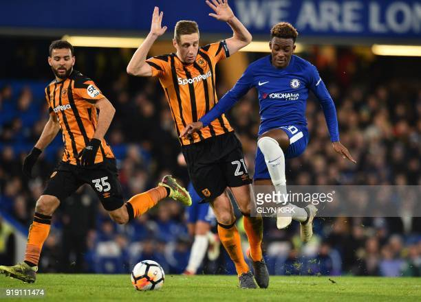 Chelsea's English striker Callum HudsonOdoi passes Hull City's English defender Michael Dawson during the English FA Cup fifth round football match...