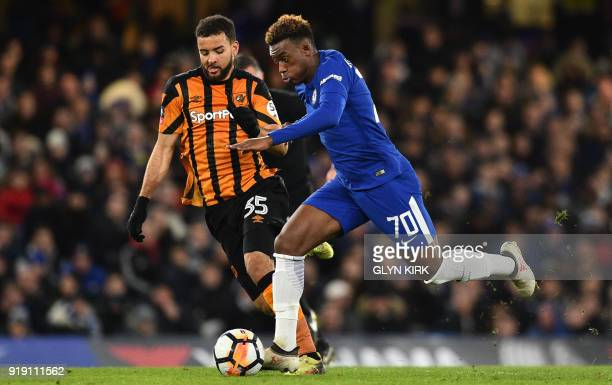 Chelsea's ENglish striker Callum HudsonOdoi vies with Hull City's English midfielder Kevin Stewart during the English FA Cup fifth round football...