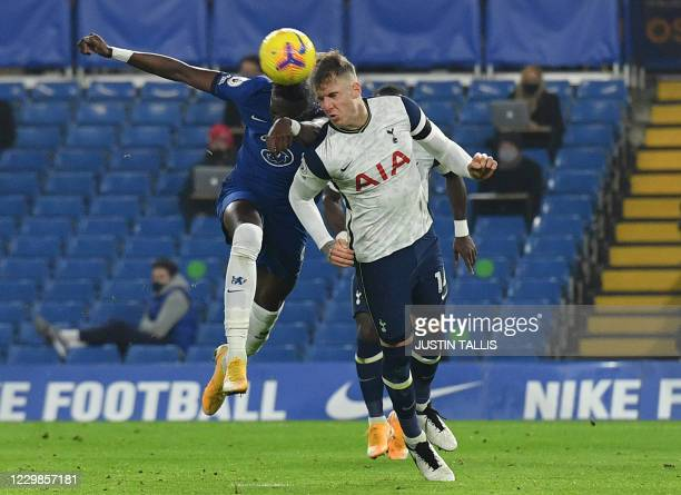 Chelsea's English striker Tammy Abraham and Tottenham Hotspur's Welsh defender Joe Rodon clash heads as they head the ball during the English Premier...