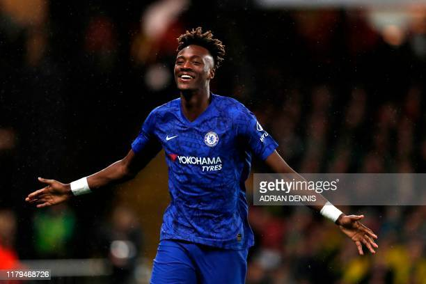 Chelsea's English striker Tammy Abraham celebrates scoring his team's first goal during the English Premier League football match between Watford and...