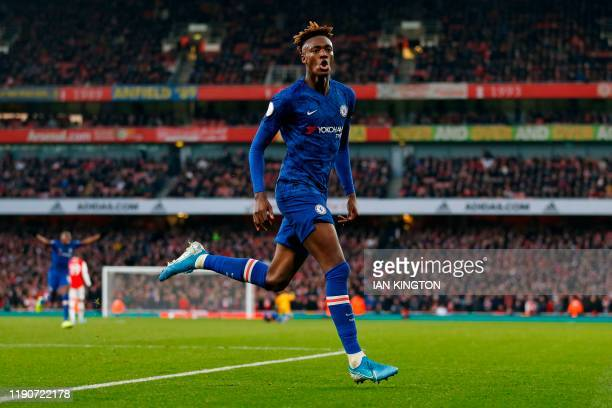 Chelsea's English striker Tammy Abraham celebrates scoring their second goal to take the lead 12 during the English Premier League football match...
