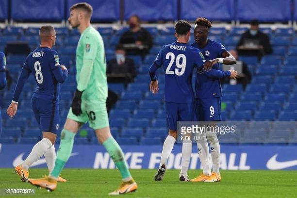 Chelsea's English striker Tammy Abraham celebrates with Chelsea's German midfielder Kai Havertz after scoring the opening goal during the English...