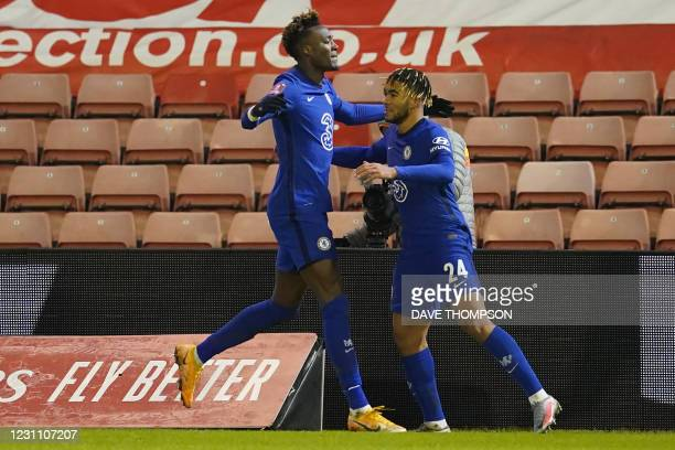 Chelsea's English striker Tammy Abraham celebrates with Chelsea's English defender Reece James after scoring the opening goal of the English FA Cup...