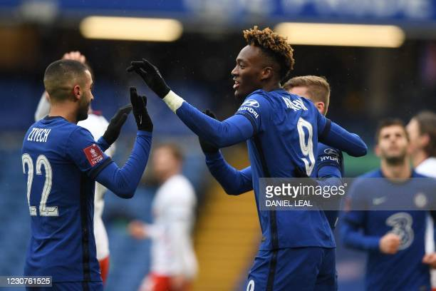 Chelsea's English striker Tammy Abraham celebrates with teammates after scoring the opening goal of the English FA Cup fourth round football match...