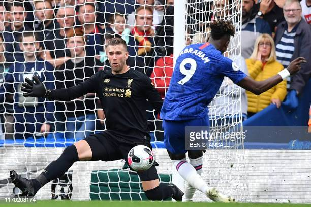 Chelsea's English striker Tammy Abraham has this shot saved by Liverpool's Spanish goalkeeper Adrian during the English Premier League football match...