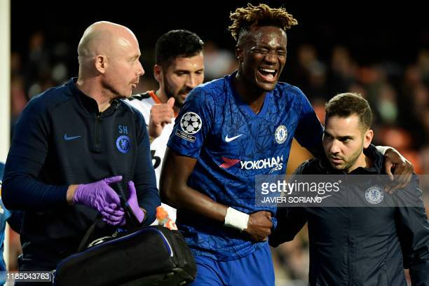 Chelsea's English striker Tammy Abraham is helped after resulting injured during the UEFA Champions League Group H football match between Valencia CF...