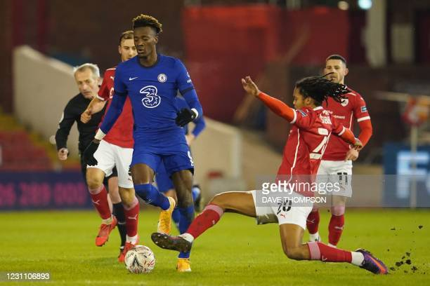 Chelsea's English striker Tammy Abraham is tackled by Barnsley's English defender Toby Sibbick during the English FA Cup fifth round football match...