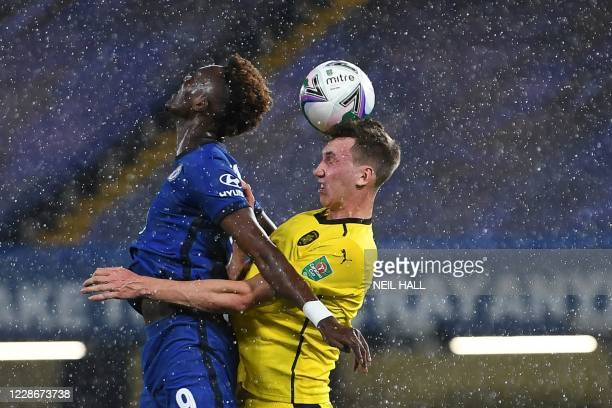 Chelsea's English striker Tammy Abraham jumps for the ball with Barnsley's Finnish defender Aapo Halme during the English League Cup third round...
