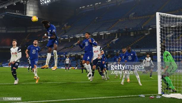 Chelsea's English striker Tammy Abraham jumps while defending a corner during the English Premier League football match between Chelsea and Tottenham...