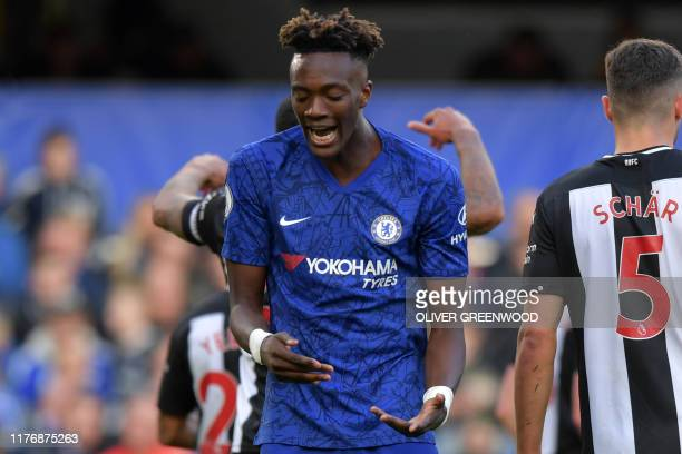 Chelsea's English striker Tammy Abraham reacts after hitting the bar with a header during the English Premier League football match between Chelsea...