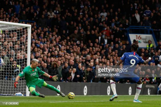 Chelsea's English striker Tammy Abraham scores his team's first goal during the English Premier League football match between Chelsea and Crystal...