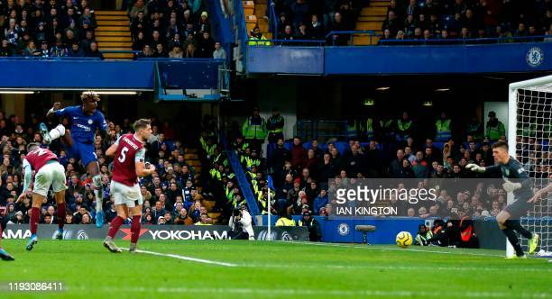 Chelsea's English striker Tammy Abraham scores his team's second goal during the English Premier League football match between Chelsea and Burnley at...