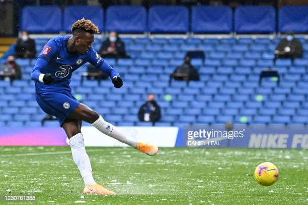 Chelsea's English striker Tammy Abraham shoots to score the opening goal of the English FA Cup fourth round football match between Chelsea and Luton...