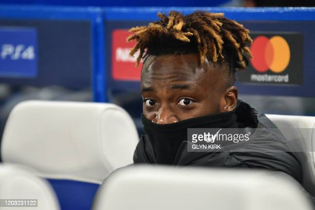 Chelsea's English striker Tammy Abraham takes his place on the bench for the UEFA Champion's League round of 16 first leg football match between...