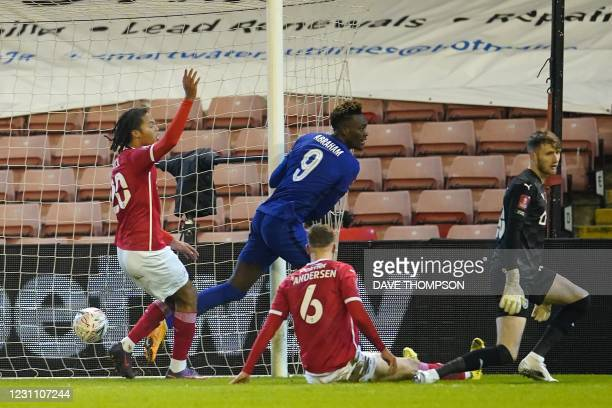 Chelsea's English striker Tammy Abraham turns to celebrate after scoring the opening goal of the English FA Cup fifth round football match between...