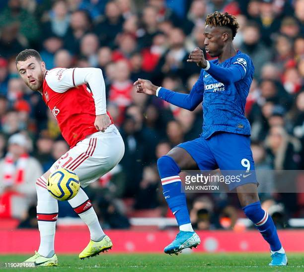 Chelsea's English striker Tammy Abraham vies with Arsenal's English defender Calum Chambers during the English Premier League football match between...