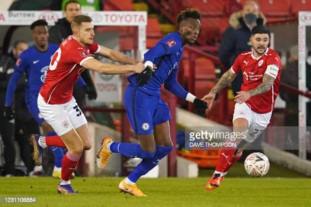 Chelsea's English striker Tammy Abraham vies with Barnsley's Polish defender Michal Helik and Barnsley's English midfielder Alex Mowatt during the...