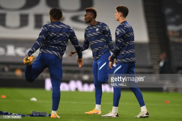 Chelsea's English striker Tammy Abraham warms up with teammates before the English League Cup fourth round football match between Tottenham Hotspur...