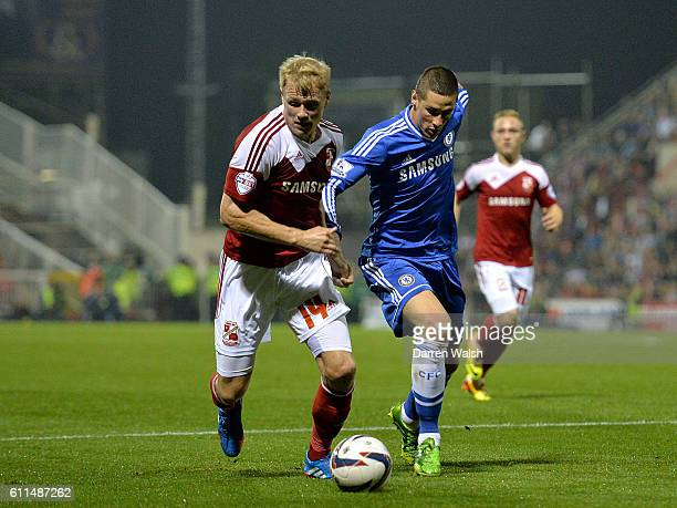 Chelsea's Fernando Torres and Swindon Town's Jay McEveley battle for the ball