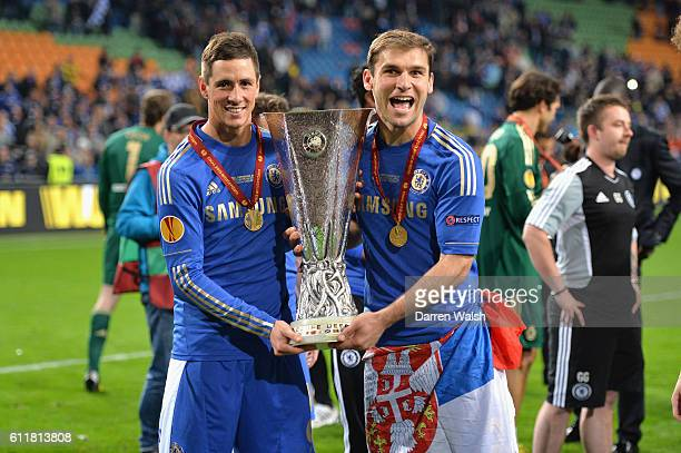 Chelsea's Fernando Torres Branislav Ivanovic celebrates winning the Europa League trophy after winning the UEFA Europa League Final match between FC...