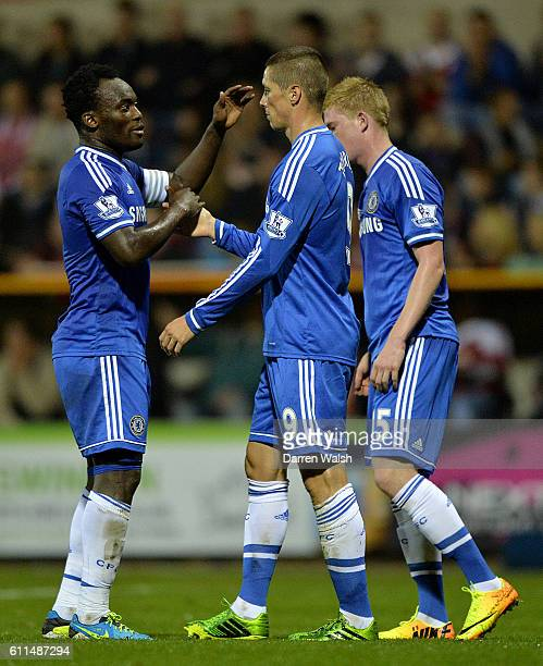 Chelsea's Fernando Torres celebrates scoring his teams first goal of the game with teammate Michael Essien and Kevin De Bruyne