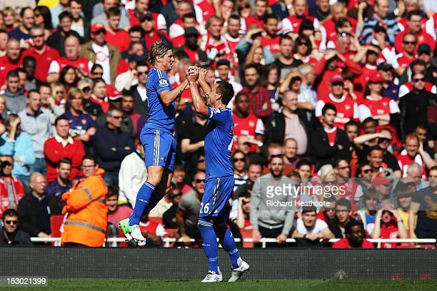 Chelsea's Fernando Torres celebrates scoring the first goal of the match with teammate John Terry during the Barclays Premier League match between...