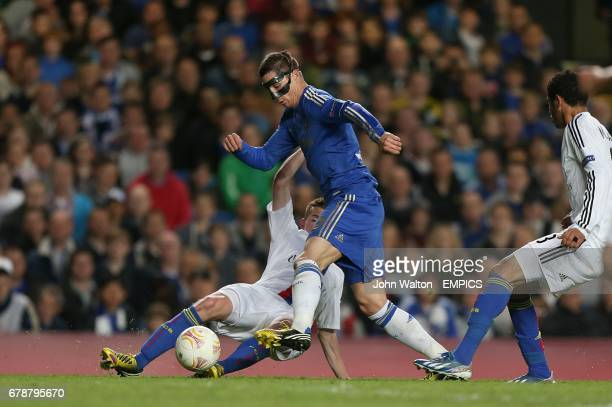 Chelsea's Fernando Torres goes down under a challenge from Basel's Fabian Frei